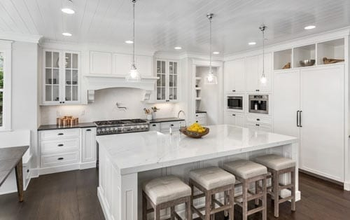 Image of white kitchen with table counter top